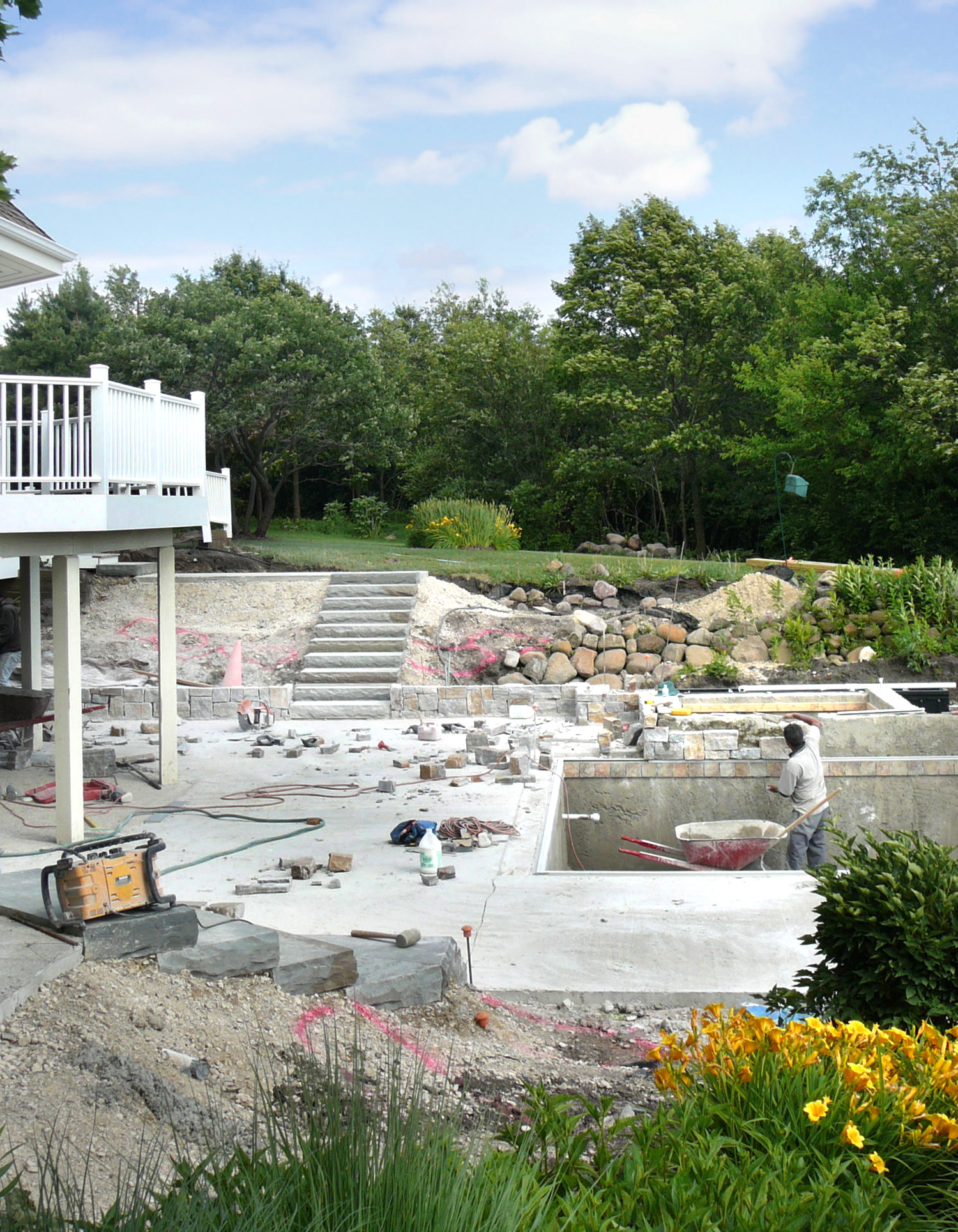 The pool's edge waterfall construction begins