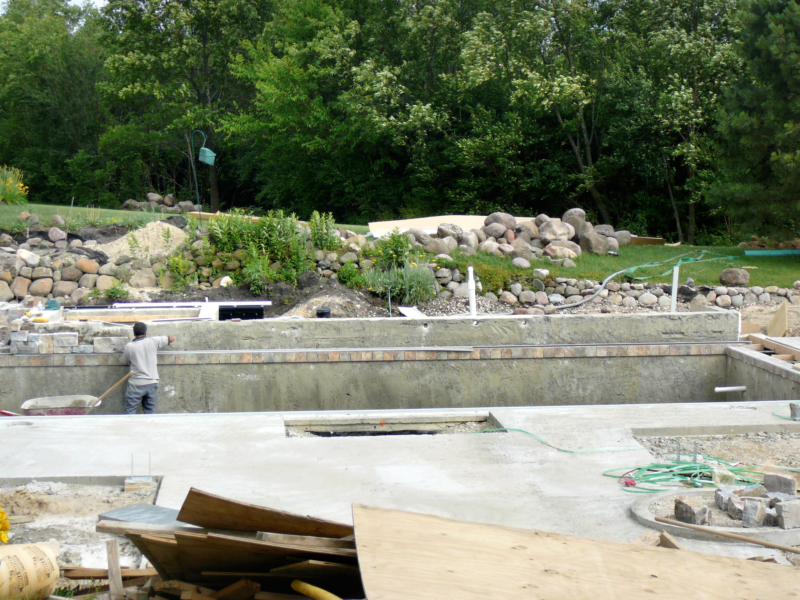 Wide angle view of Stonewood Design Group's waterfall construction feature