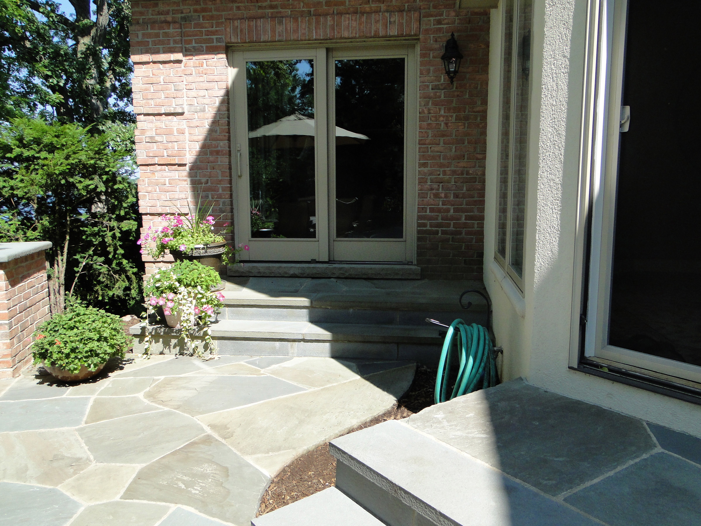 Expert craftsmanship form this blue stone step into the home