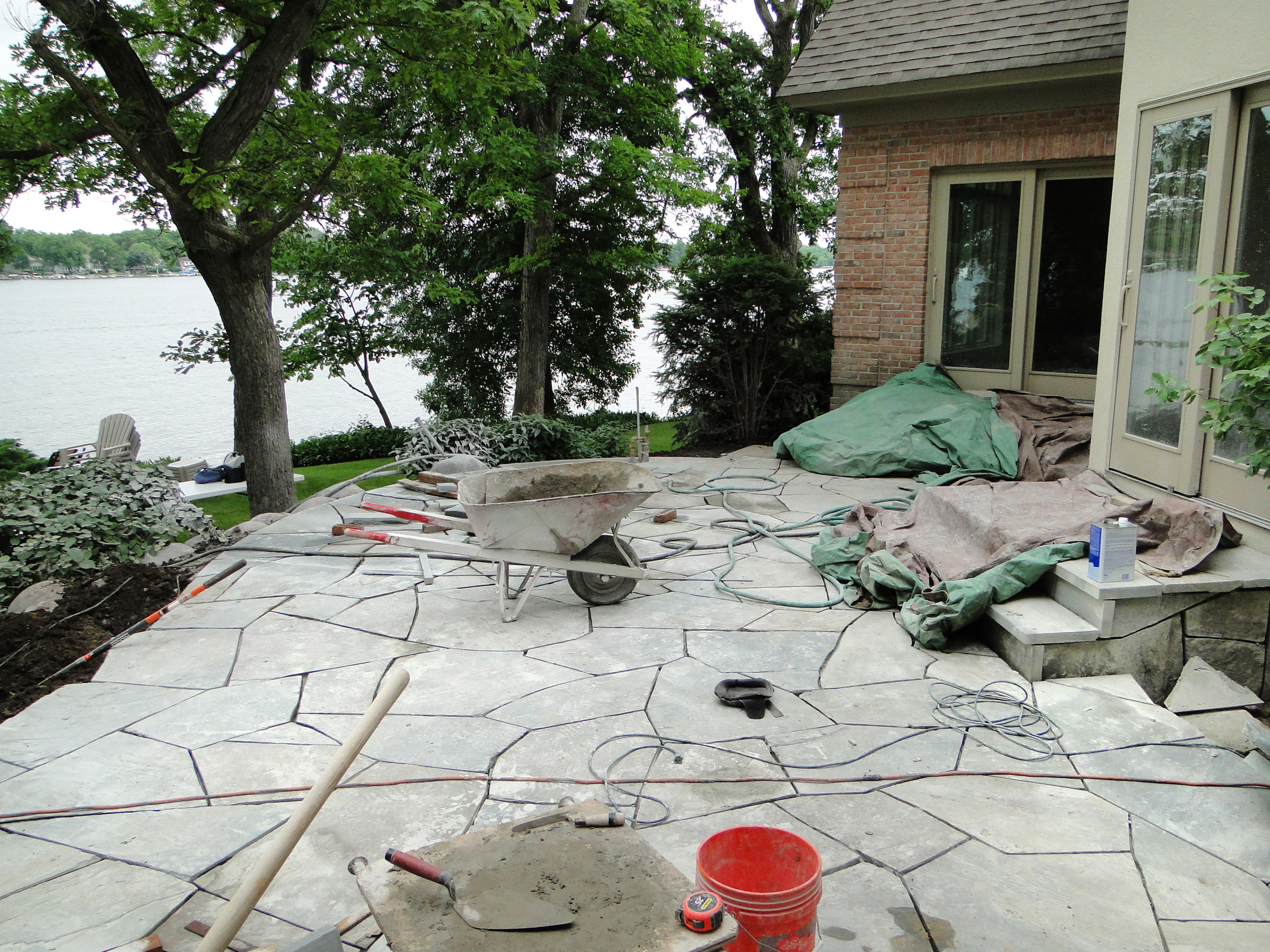 Irregular full range blue stone will replace the old concrete patio