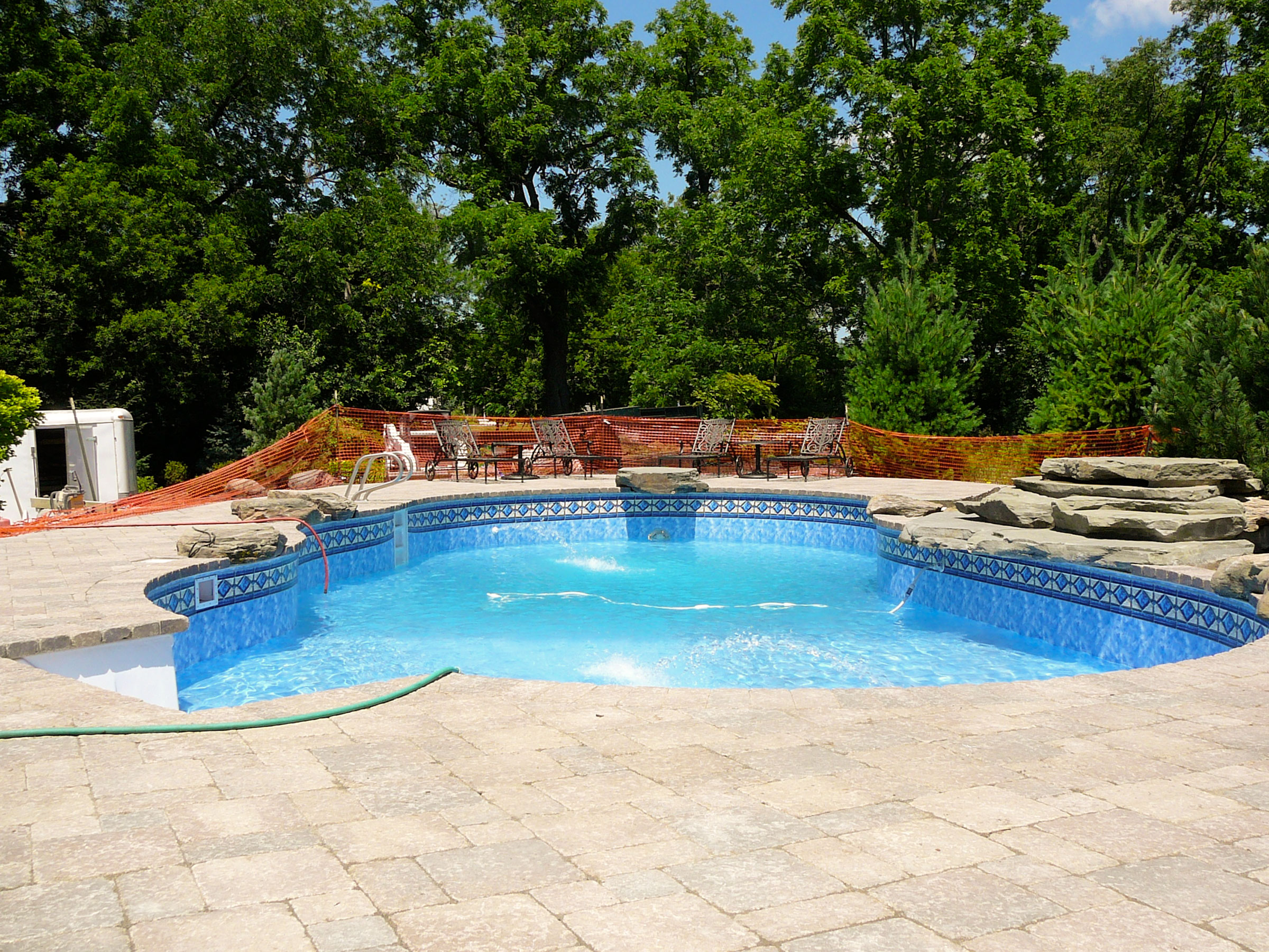 Completion of paver stone patio and bluestone waterfall and diving rock