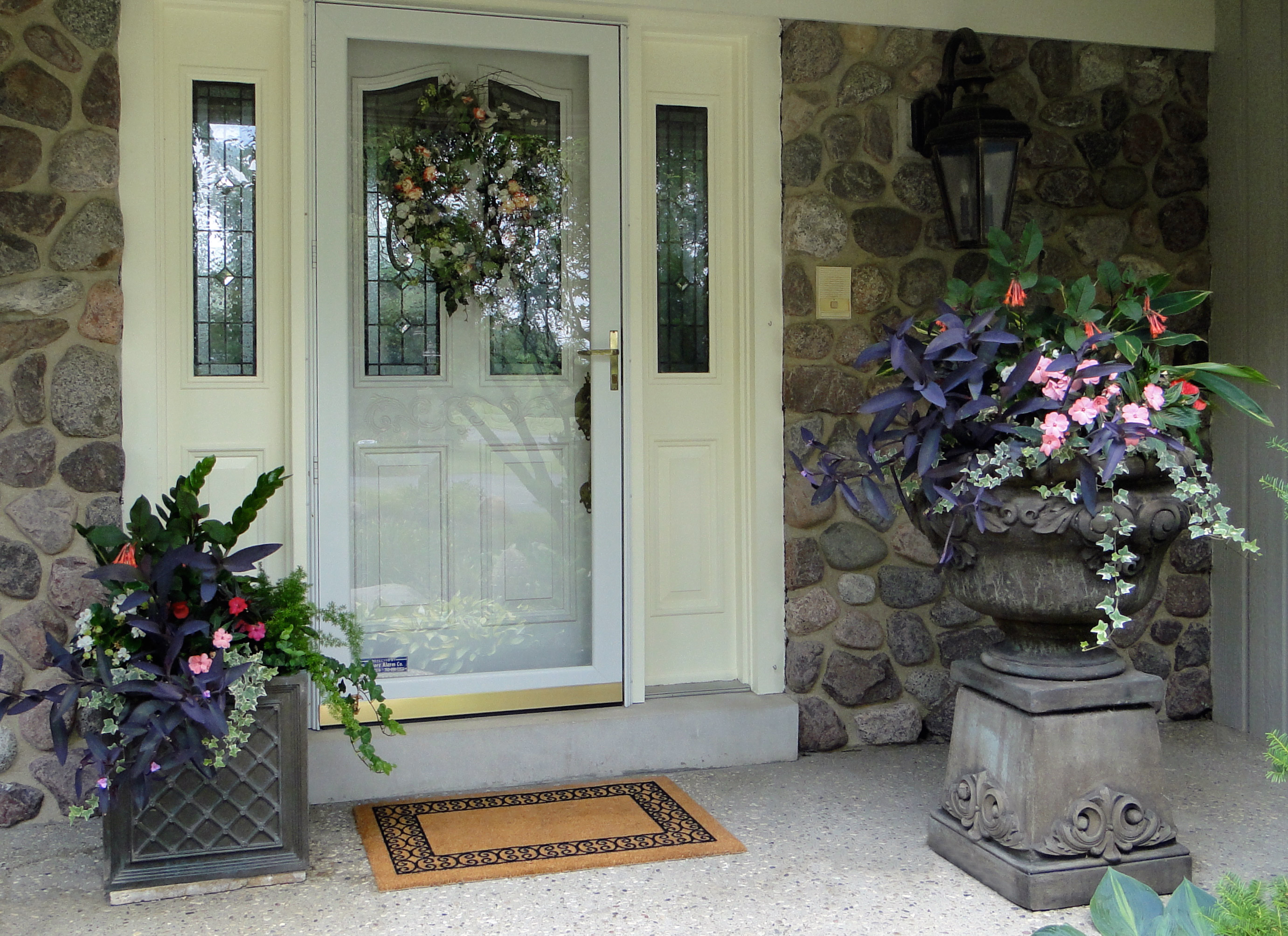 Container garden groupings can enhance the entryway of a home