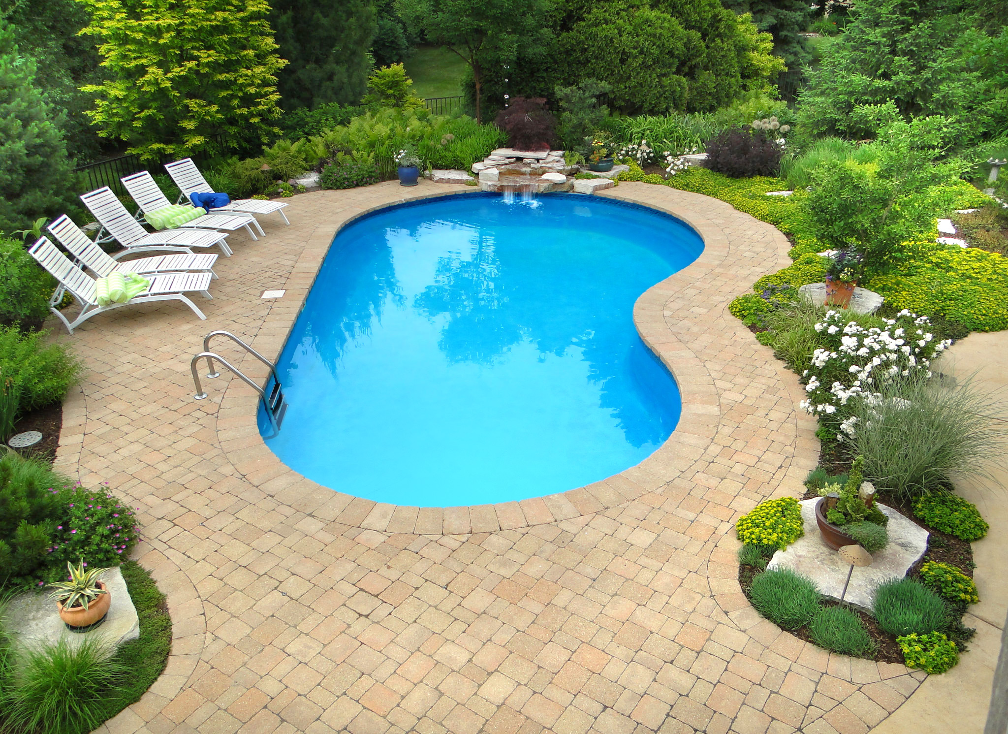 Stonewood Design Group will create a design to suit the style and personality of your property, like this hardscaped pool.