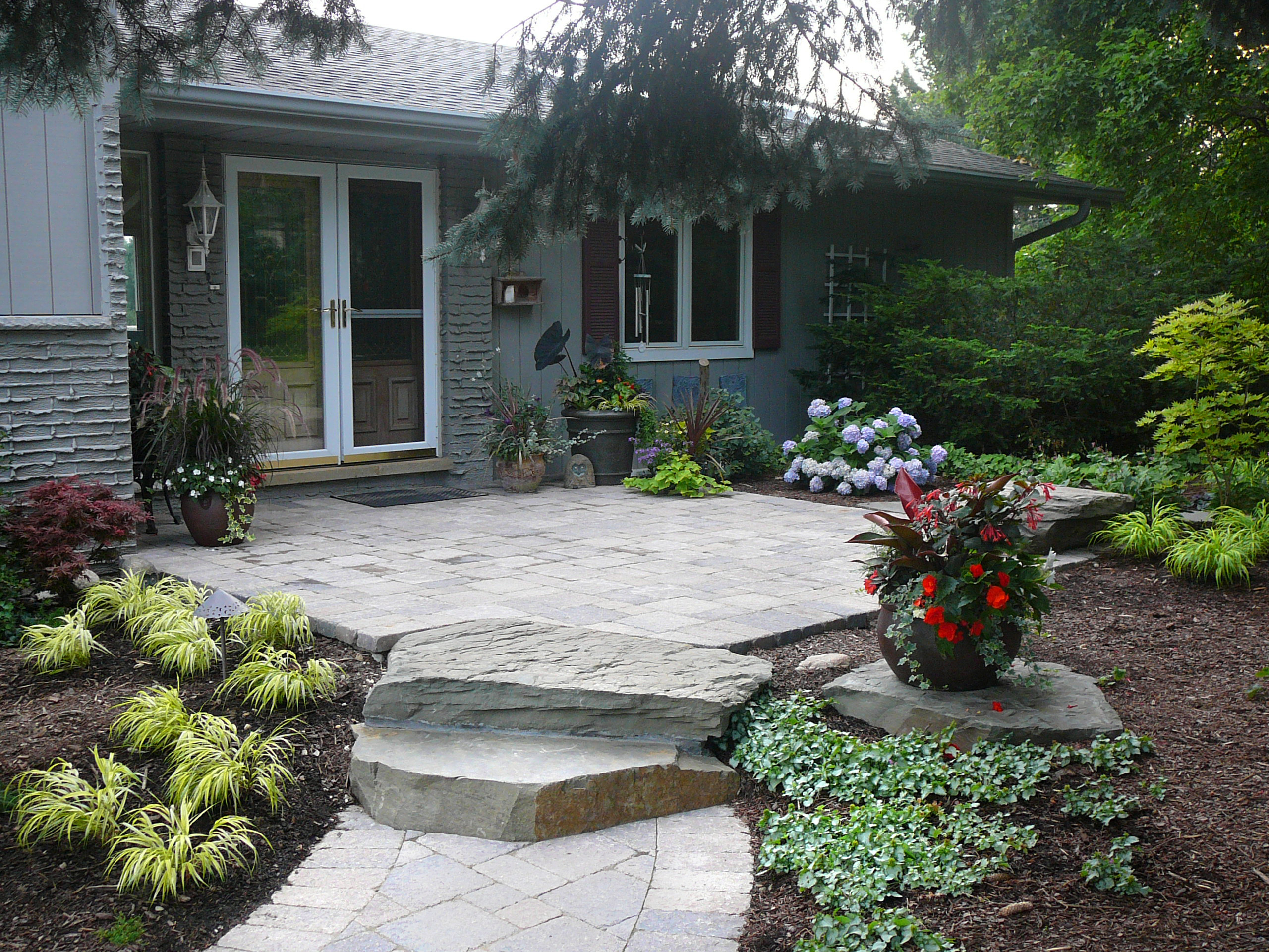 This large paver stone patio serves as a relaxing and inviting entryway to this Crystal Lake home.