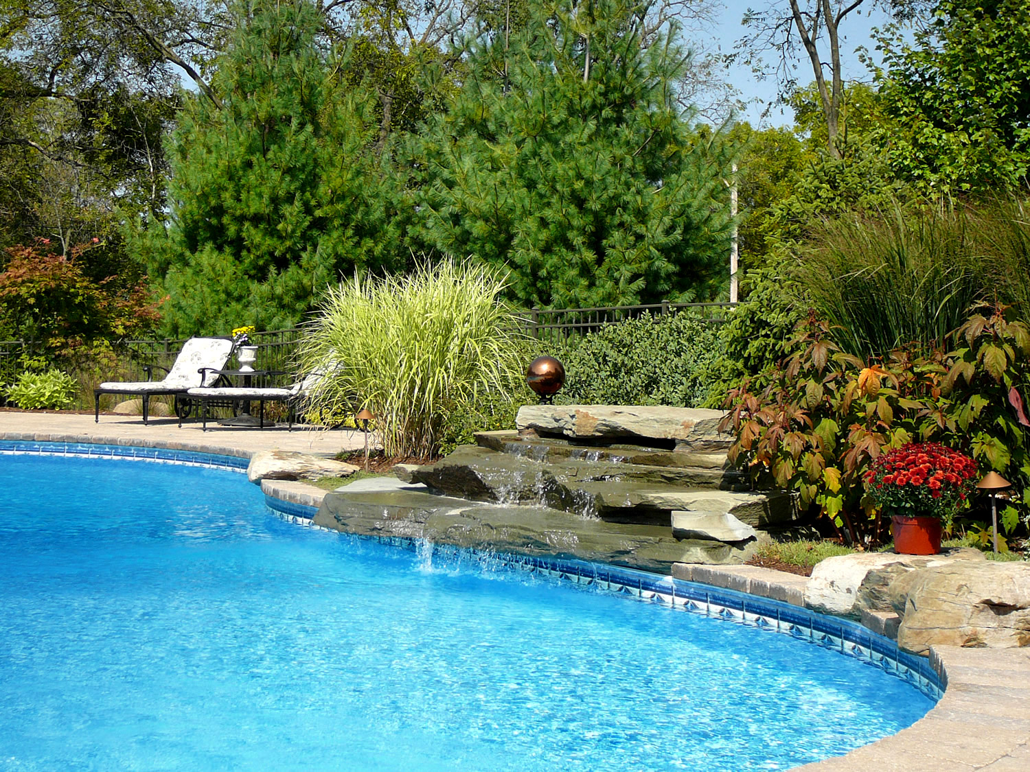 Waterfalls are an awesome addition to any pool hardscape