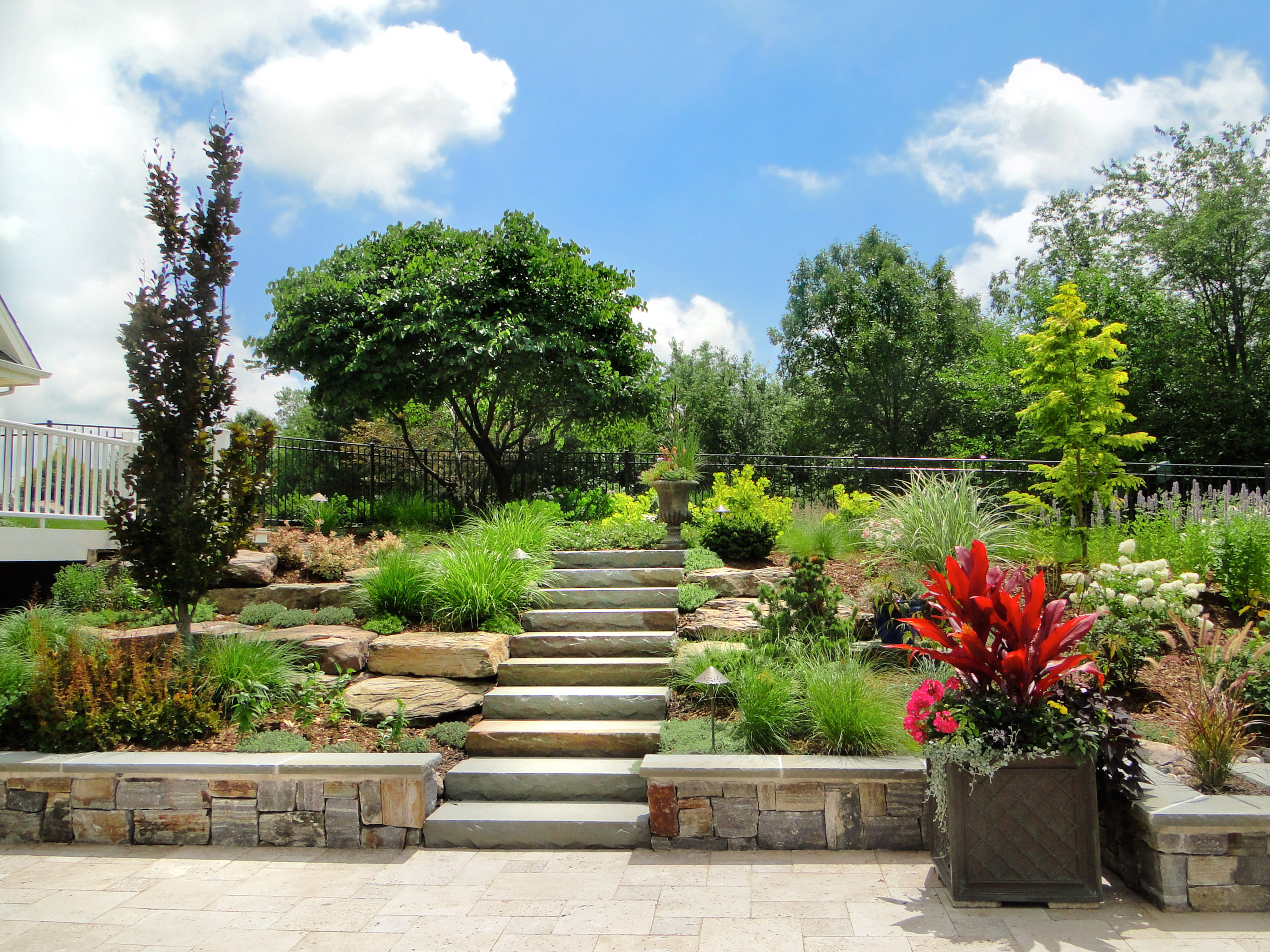 Our designs combine a diverse mix of native and hybridized plants with natural stonework.