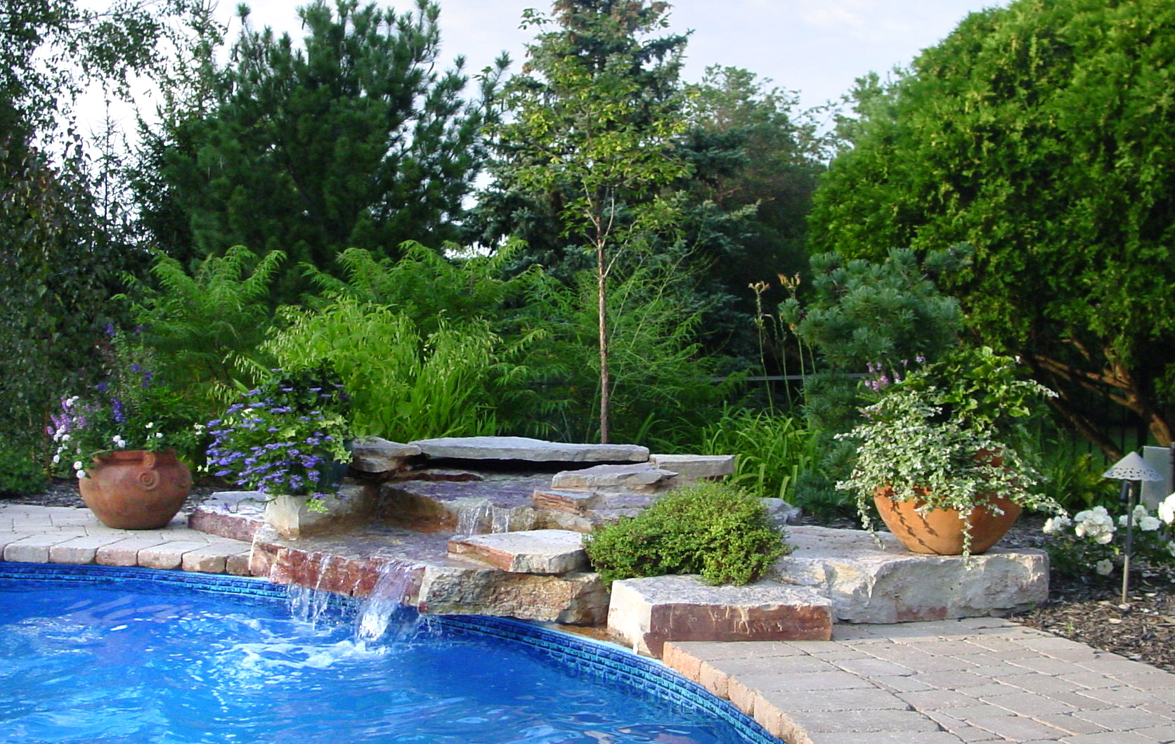 You can enjoy the tranquil sights and sounds of falling water as you relax poolside
