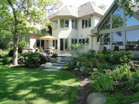 Lakeside home hardscaped and landscaped by Stonewood Design Group