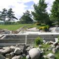 Backyard renovation begins at our Bull Valley project, with natural stone ready to be installed