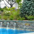 American Granite veneer bluestone wall with waterfall features in operation