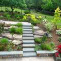 Completed natural bluestone steps lead from the house to the poolside