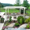 Comfortable outdoor living space with a firepit and lounges under a pergola