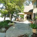 Irregular full range bluestone patio overlooking lake.