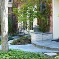 This Bluestone walk and landing and the surrounding landscaping creates an elegant and inviting entryway for this north shore home.