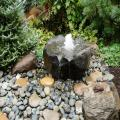A dish rock fountain display created by Stonewood Design Group