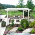 Stonewood Design Group creates awesome outdoor living rooms, like this pergola patio area.
