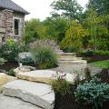 Large outcropping stone placed within small gardens create this grand staircase.