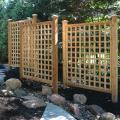 A trellis not only adds beauty to your landscape but function as well, in this case creating an intimate space.